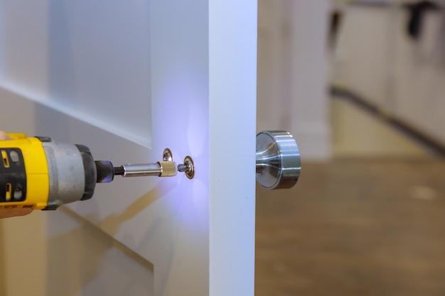Handyman installing the door lock