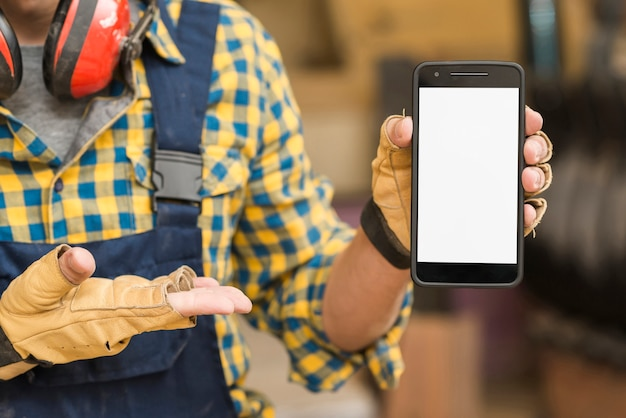Handyman's hand showing smartphone with white screen