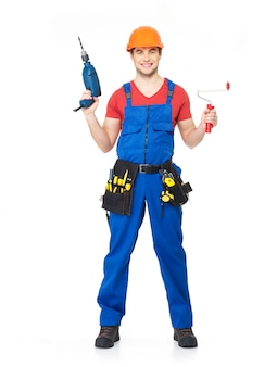 Handyman with tool drill and brush  full portrait over white wall
