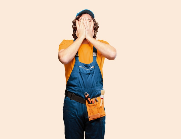 Handyman worker covering his face