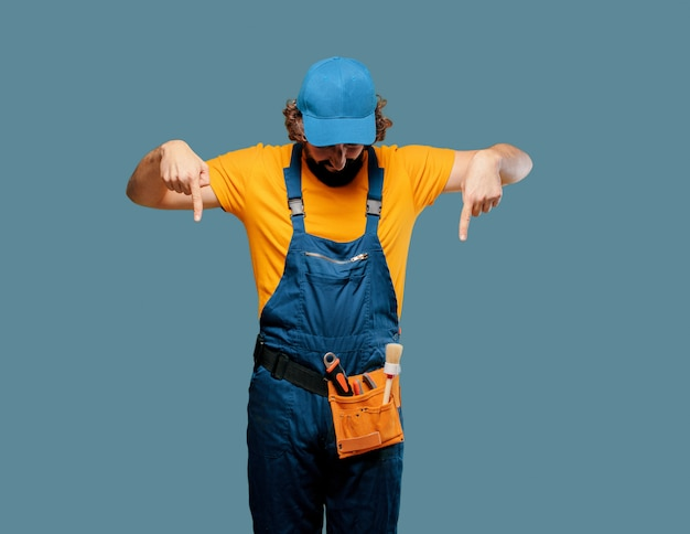 Handyman worker pointing to the side