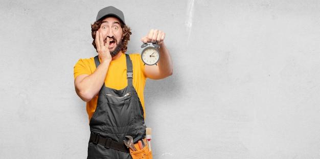 Handyman worker  with alarm clock