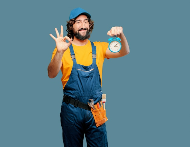 Handyman worker  with alarm clock