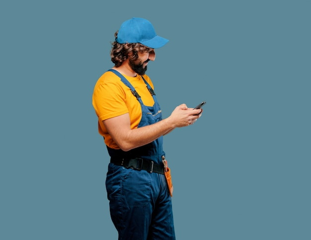Handyman worker  with a smart phone