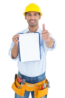 Handyman in yellow hard hat with clipboard gesturing thumbs up