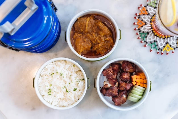 Hang lay pork curry and stir fried spare rib pork with carrot and cucumber.