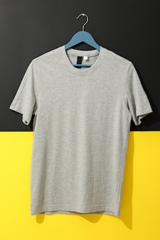 Hanger with blank gray t-shirt on two tone