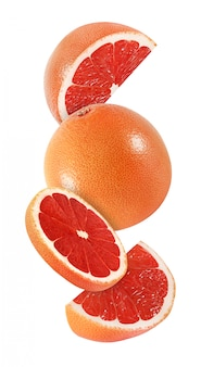 Hanging, falling and flying piece of grapefruit fruits isolated on white background with clipping path