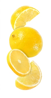 Hanging, falling and flying piece of lemon fruits isolated