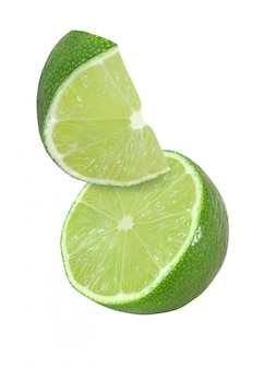 Hanging, falling and flying piece of lime fruits isolated