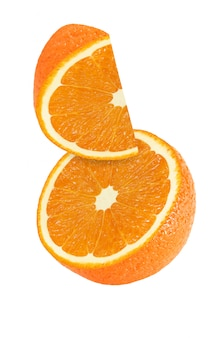 Hanging, falling and flying piece of orange fruits isolated on white background with clipping path