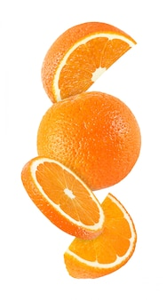 Hanging, falling and flying piece of orange fruits isolated