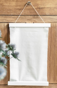 A hanging frame on a wooden wall