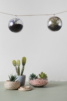 Hanging glass ornaments with minimal vases
