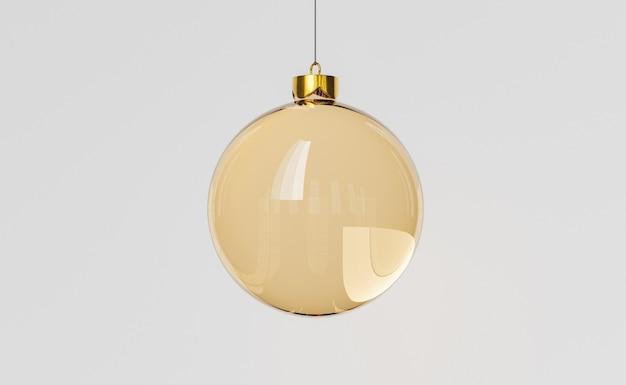 金色のガラスのクリスマスボールをぶら下げ