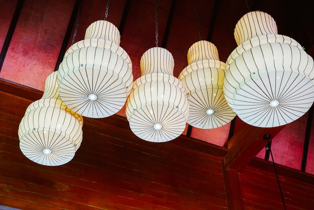 Hanging lamps on red ceiling