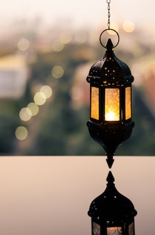 Hanging lantern with dusk sky for ramadan kareem.