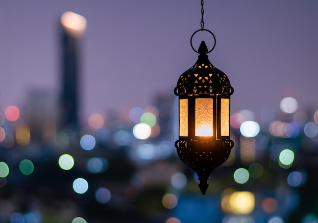 Hanging lantern with night sky for ramadan kareem.