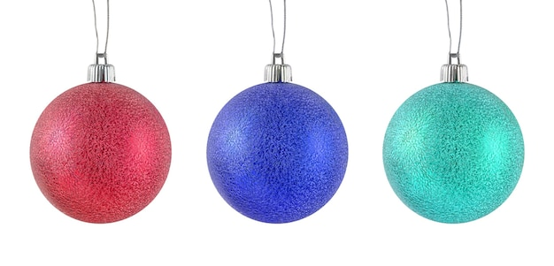 Hanging red, blue, turquoise metallic shiny christmas baubles set isolated on a white background.