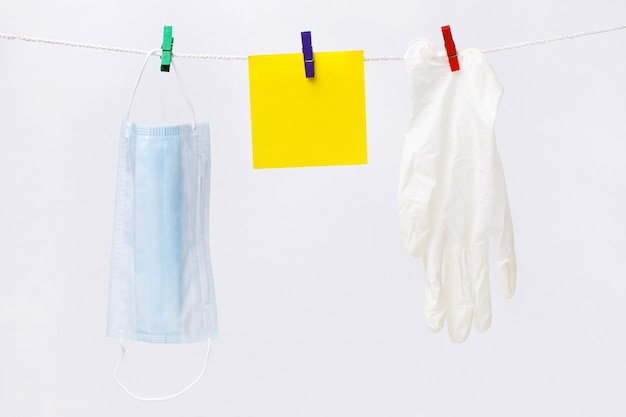 Hanging on a rope medical mask with protective gloves, coronavirus concept, covid-19 in the world