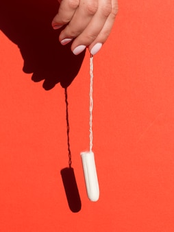 Hanging tampon held by hand