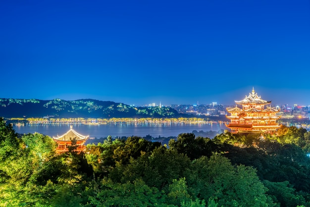 Hangzhou city nightscape and ancient pavilion
