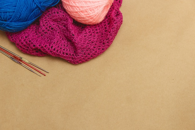Hanks of bright yarn for knitting on a bright background