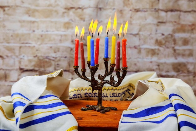 Hanuka menorah with burning candles.