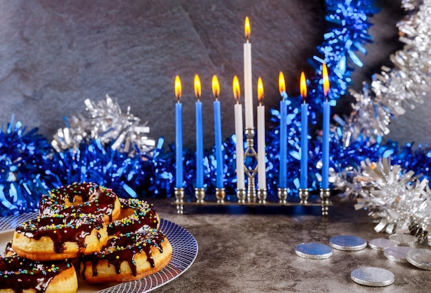 Hanukkah menorah, donuts, chocolate coins and decoration