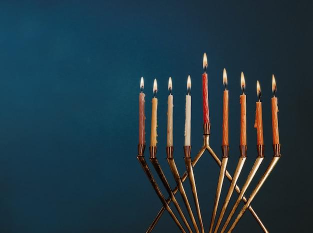 Hanukkah menorah with candles for chanukah celebrationon black background