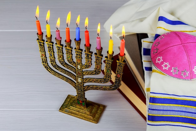 Hanukkah menorah with candles happy burning