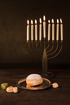 Hanukkah snack and symbols on table