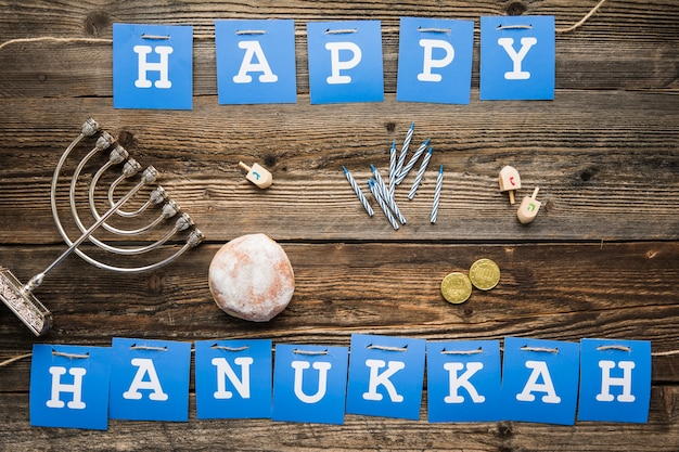 Hanukkah symbols lying near writing