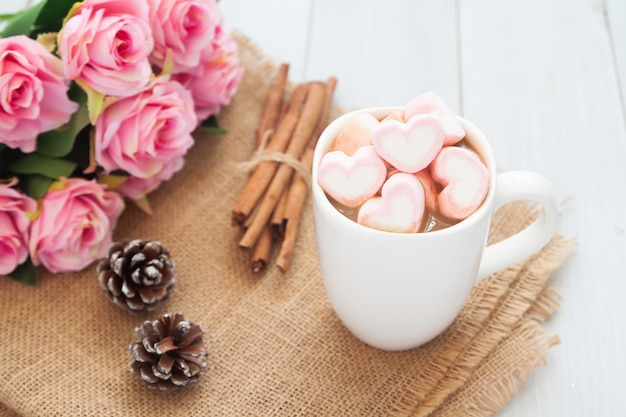 Happiness moment. sweet beverage, hot chocolate with pastel marshmallows