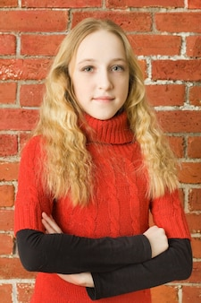 Happiness teenager girl in red sweater