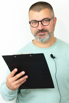 Happt bearded businessman coach wearing glasses with microphone and clipboard.