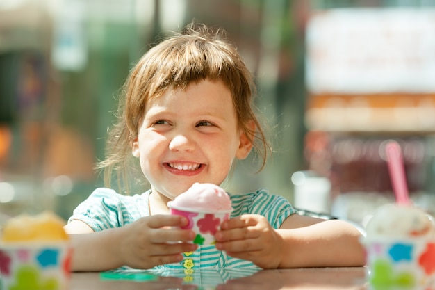 Happy 3 years girl eating ice cream