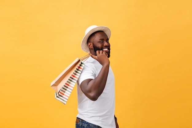 Happy african american man holding shopping bags