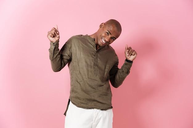Happy african man posing in studio and looking