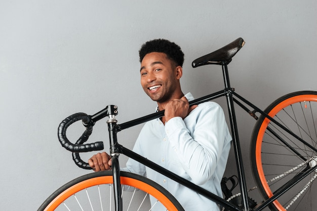 Happy african man with bicycle
