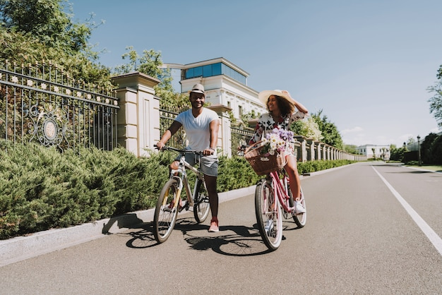 Happy afro american couple. cycling date concept.