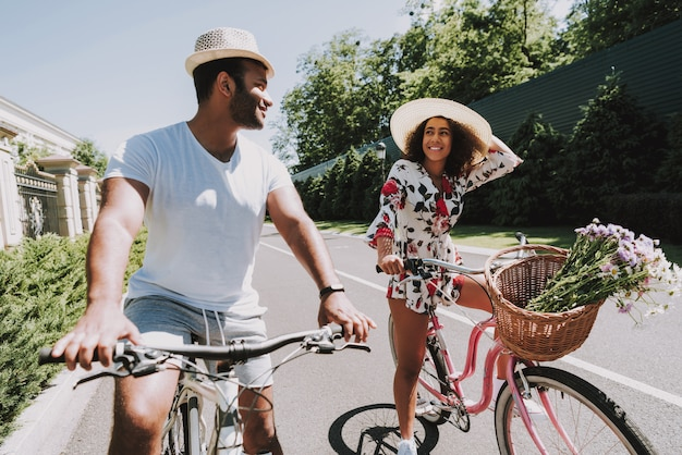 Happy afro american couple cycling date concept