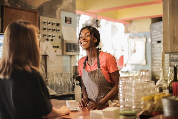 Happy afro bartender girl