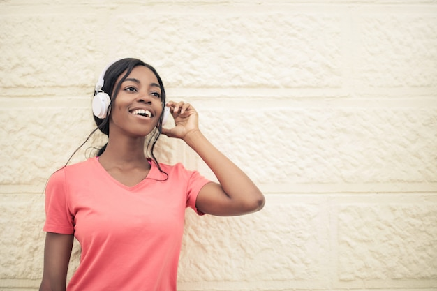 Happy afro girl listening to music