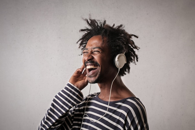 Happy afro man listening to music
