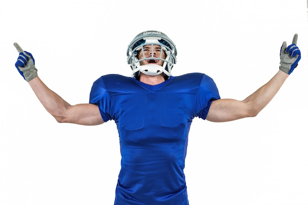 Happy american football player with arms outstretched
