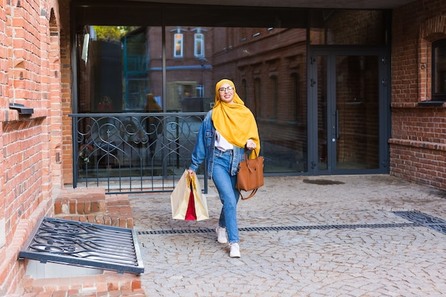 Happy arab muslim woman with shopping bags