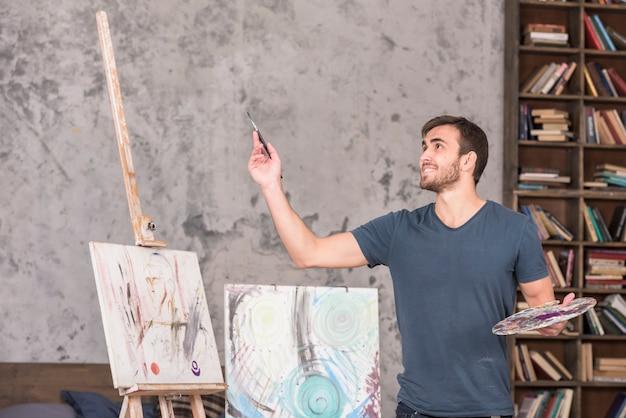 Happy artist in studio