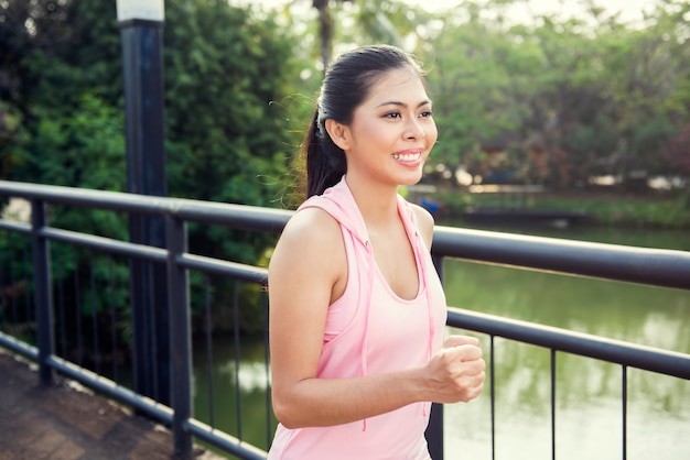 Happy asian athlete woman running