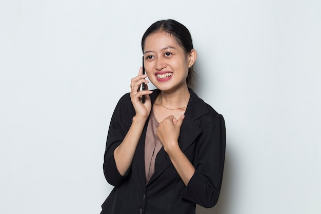 Happy asian business woman with mobile phone